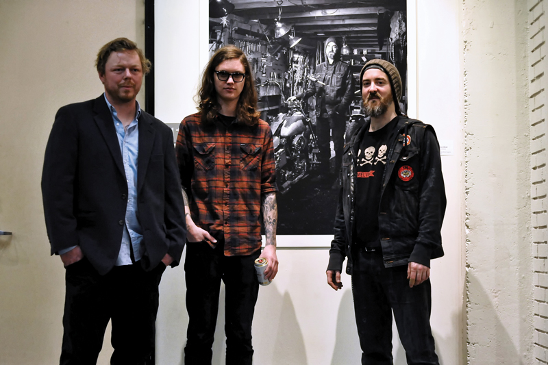 Left to right: Jason Coatney, Jordan Conway and Tony Morgan with one of Conway's photographs.