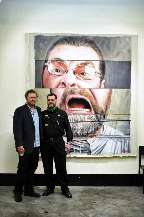 Left to right: Painter Jason Coatney with artist Zack Kosta in front of Coatney's painting of Kosta.