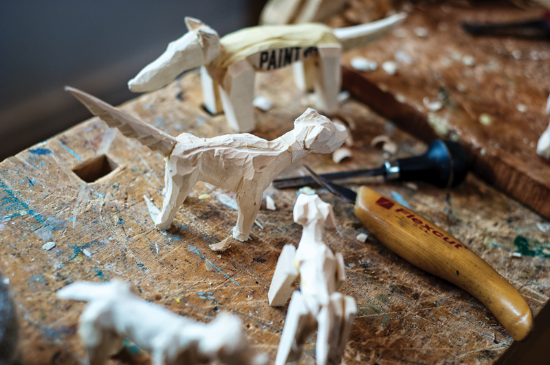 """Rescue Dogs"" in the works. These figures are made from scraps in Peterson's studio. The idea is to carve dogs small enough that they can fit in one's hand. Photo by Miri Stebivka."