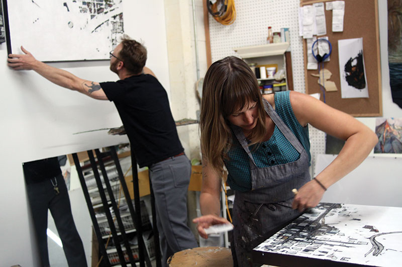 Artists Tyler Corbett and Erinn Kathyrn working in their studio Friday, May 2, 2014. Photograph by Mary Locke.