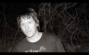 Still: Elliott Smith on on tour, circa 1998.  Photo Credit: Heaven Adores You